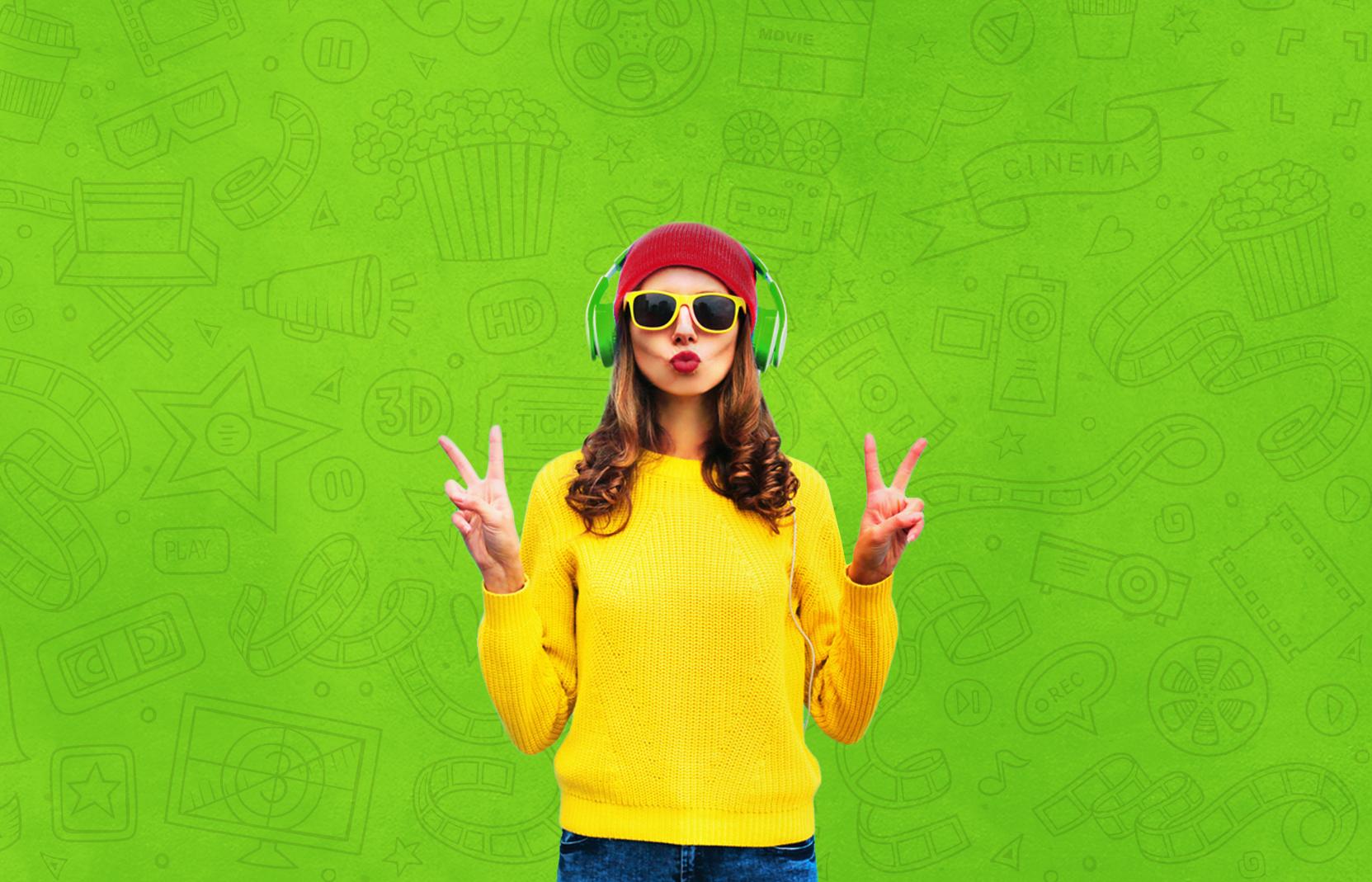 Ragazza con cuffie per ascoltare musica col digital rewarding